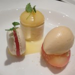 Lemon curd mousse, poached white peach, iced tea sorbet, macaroon.